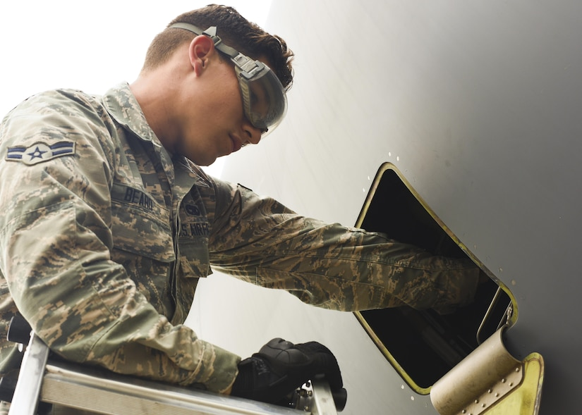 Airman 1st Class Zack Beard, 437th Aircraft Maintenance Squadron crew chief, adds oil to one of four engines mounted on a C-17 Globemaster III at Joint Base Charleston, S.C. July 17, 2017. The 437th AMXS is made up of combat-ready maintainers who inspect and service JB Charleston's fleet of C-17s. The maintenance these Airmen perform enables Air Mobility Command's mission to sustain rapid global mobility at a moment's notice.