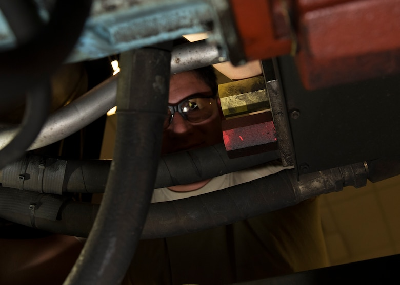 Senior Airman Austin Ready, 92nd Aerospace Ground Equipment journeyman, inspects the hoses on a hydraulic cart July 19, 2017, at Fairchild Air Force Base, Washington. AGE flight conducts regular inspections of all equipment to ensure its continued reliability. (U.S. Air Force photo / Airman 1st Class Ryan Lackey)