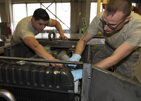 Senior Airman Austin Ready, 92nd Aerospace Ground Equipment journeyman and Staff Sgt. Brandon Baltis, 92nd AGE craftsman, test the connections and fittings on a power generator cart July 19, 2017, at Fairchild Air Force Base, Washington. Powerful mobile generators are necessary to provide aircraft with enough power to cold-start its engines. (U.S. Air Force photo / Airman 1st Class Ryan Lackey)