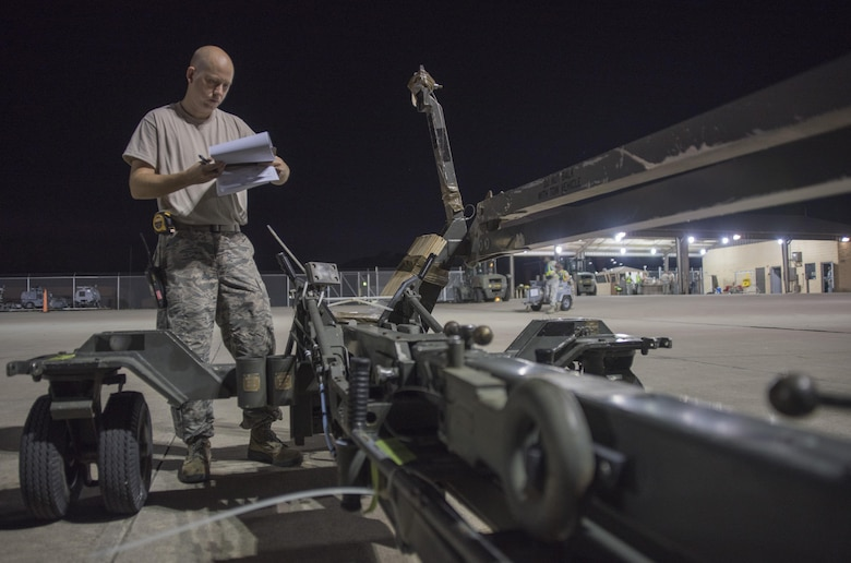 Staff Sgt. Richard Averitt, 4th Logistics Readiness Squadron air transportation specialist, verifies the dimensions and weight of a weapon loader to be loaded onto an aircraft July 20, 2017, at Seymour Johnson Air Force Base, North Carolina. This cargo was part of exercise Thunderdome 17-02, which is designed to evaluate the 4th Fighter Wing's ability to generate and deploy aircraft, Airmen and equipment. (U.S. Air Force photo by Tech. Sgt. David W. Carbajal)