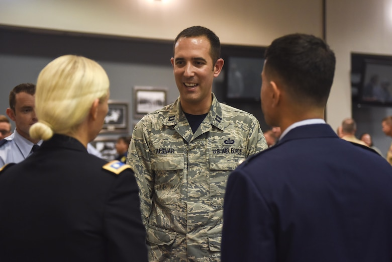 U.S. Air Force Capt. Todd Afshar, 315th Training Squadron Flight Commander, introduces himself to Col. Ricky Mills, 17th Training Wing Commander, at the Event Center on Goodfellow Air Force Base, Texas, July 21, 2017. Col. Mills met base personnel to learn more about the mission and the Airmen that enable it. (U.S. Air Force photo by Airman 1st Class Chase Sousa/Released)