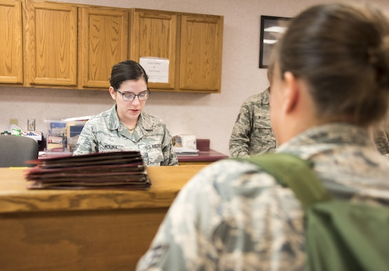 Senior Airman Natalie Molina, 4th Force Support Squadron, reviews a deployer's mobility folder at the PDF processing center July 20, 2017, at Seymour Johnson Air Force Base, North Carolina. The pre-deployment processing was to ensure the deployers had all necessary documents and gear prior to departing. (U.S. Air Force photo by Tech. Sgt. David W. Carbajal)
