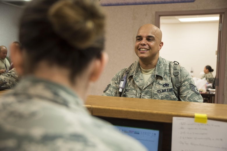 Staff Sgt. Daniel Diaz, 335th Fighter Squadron weapons technician, waits as his mobility folder is reviewed at the pre-deployment function line processing center July 20, 2017, at Seymour Johnson Air Force Base, North Carolina. As part of exercise Thunderdome 17-02, Diaz and several other 4th Fighter Wing Airmen are deploying to evaluate the wing's ability to rapidly deploy for contingency operations. (U.S. Air Force photo by Tech. Sgt. David W. Carbajal)