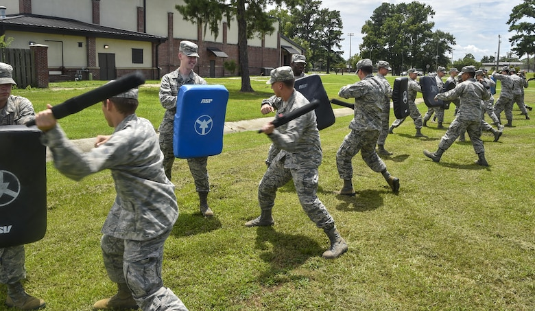 Airmen practice with less-than-lethal weapons during an augmentee training course at Joint Base Charleston, S.C., July 18, 2017. Augmentees are called to service during emergencies as well as situations where extra security forces members are needed.