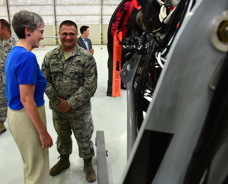 Secretary of the Air Force Heather Wilson shares a laugh with Master Sgt. Eric, 432nd Aircraft Maintenance Squadron production superintendent, July 19, 2017, at Creech Air Force Base, Nev. Eric briefed the SecAF on an engine trainer he created in his spare time to fill a training need within the squadron. He said it was a unique opportunity to show her his creation. (U.S. Air Force photo/Senior Airman Christian Clausen)