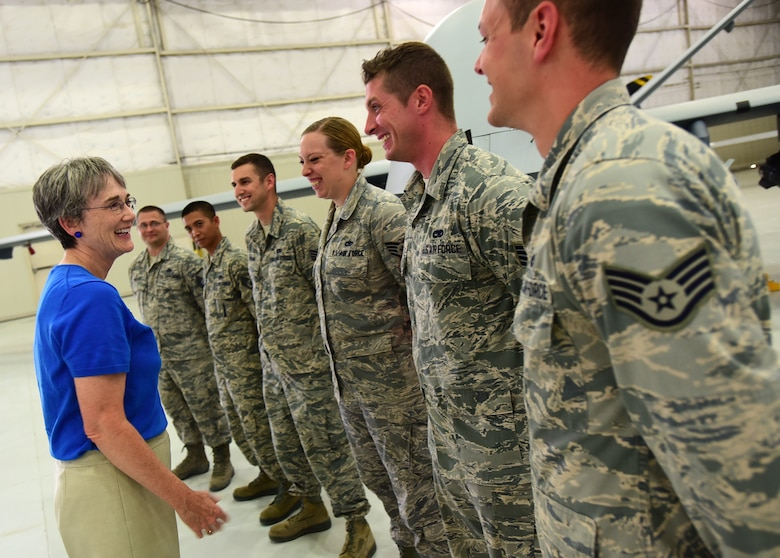 Secretary of the Air Force Heather Wilson shares a laugh with members of the 432nd Aircraft Maintenance Squadron, July 19, 2017, at Creech Air Force Base, Nev. During her visit, Wilson toured the base and gained insight into the dominant persistent attack and reconnaissance mission the Airmen of the 432nd WG complete 24/7/365 for our nation and coalition partners. (U.S. Air Force photo/Senior Airman Christian Clausen)