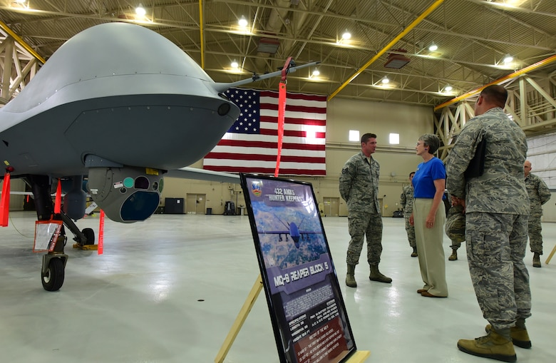 Secretary of the Air Force Heather Wilson is briefed on the Block 5 MQ-9 Reaper by Staff Sgt. Stephen, 432nd Aircraft Maintenance Squadron crew chief, July 19, 2017, at Creech Air Force Base, Nev. Wilson was able to interact with members of the 432nd Wing and learn about their mission. (U.S. Air Force photo/Senior Airman Christian Clausen)