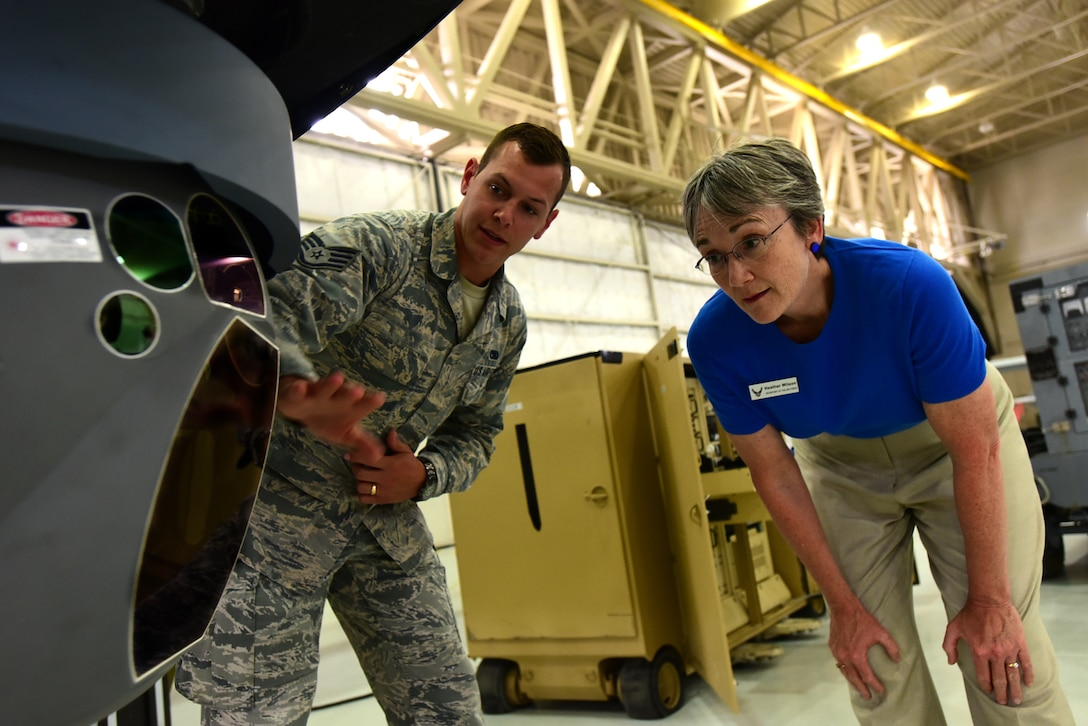 Secretary of the Air Force Heather Wilson is briefed on the Multi-Spectral Targeting system by Staff Sgt. Evan, 432nd Aircraft Maintenance Squadron avionics craftsman July 19, 2017, at Creech Air Force Base, Nev. During her visit, Wilson was briefed on the specifics on the current MQ-1 Predator and MQ-9 Reaper fleet as the missions they enable for the joint force commanders. (U.S. Air Force photo/Senior Airman Christian Clausen)