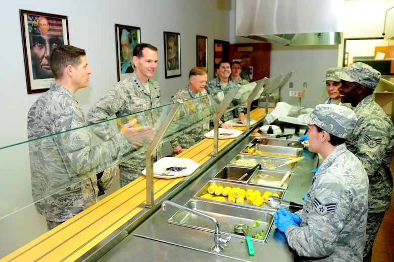 Lt. Gen. Stanley Clarke, director of the Air National Guard, visits the 194th Wing dining facility in 2015