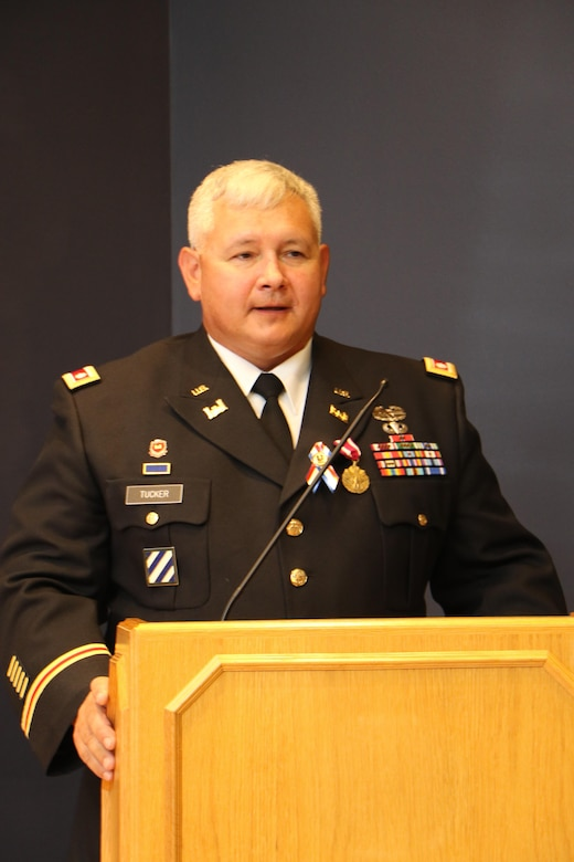 "Deputy Commander Lt. Col. John T. ""JT"" Tucker, III, speaks of the importance of family and mentors during his retirement ceremony at the U.S. Army Engineer Research and Development Center."