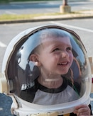 A child tries on an astronaut helmet during a National Aeronautics and Space Administration Science, Technology, Engineering, and Mathematics Day at Joint Base Andrews, Md., July 14, 2017. The event included NASA's Driven to Explore mobile exhibit, immersing attendees in NASA and specifically, the International Space Station experience. (U.S. Air Force photo by Airman 1st Class Valentina Lopez)