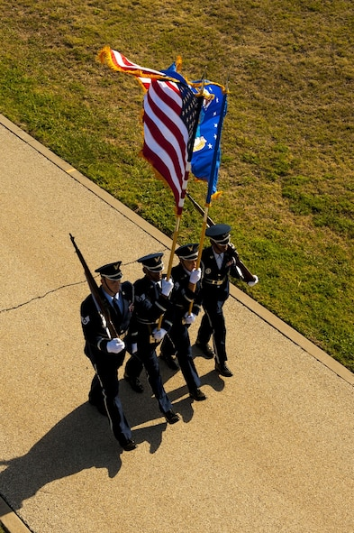 Goodfellow Air Force Base honor guard march on the parade field during the 17th Training Wing change of command on Goodfellow Air Force Base, Texas, July 21, 2017. The ceremony signifies relinquishment of command from U.S. Air Force Col. Michael Downs to Col. Ricky Mills. (U.S. Air Force photo by Senior Airman Scott Jackson/Released)