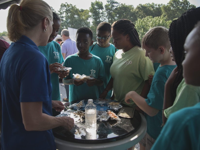 Participants examine astronaut food during a National Aeronautics and Space Administration's Science, Technology, Engineering, and Mathematics Day at Joint Base Andrews, Md., July 14, 2017. Participants learned about spaceman nutrition, astronaut suits and the International Space Station. (U.S. Air Force photo by Airman 1st Class Valentina Lopez)