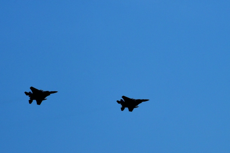 Two F-15E Strike Eagles fly overhead during Exercise Thunderdome 17-02, July 21, 2017, at Seymour Johnson Air Force Base, North Carolina. The exercise scenario tested the wing's ability to conduct a necessary rapid and appropriate response without any prior coordination. (U.S. Air Force photo by Senior Airman Ashley Maldonado)