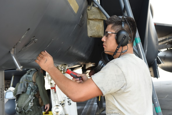 Airman 1st Class Joshua Castaneda, 4th Aircraft Maintenance Squadron crew chief, conducts a preflight inspection during exercise Thunderdome 17-02, July 21, 2017, at Seymour Johnson Air Force Base, North Carolina. By working together during the exercise, members of the 4th Fighter Wing continue to enhance deployment operations. (U.S. Air Force photo by Airman 1st Class Victoria Boyton)