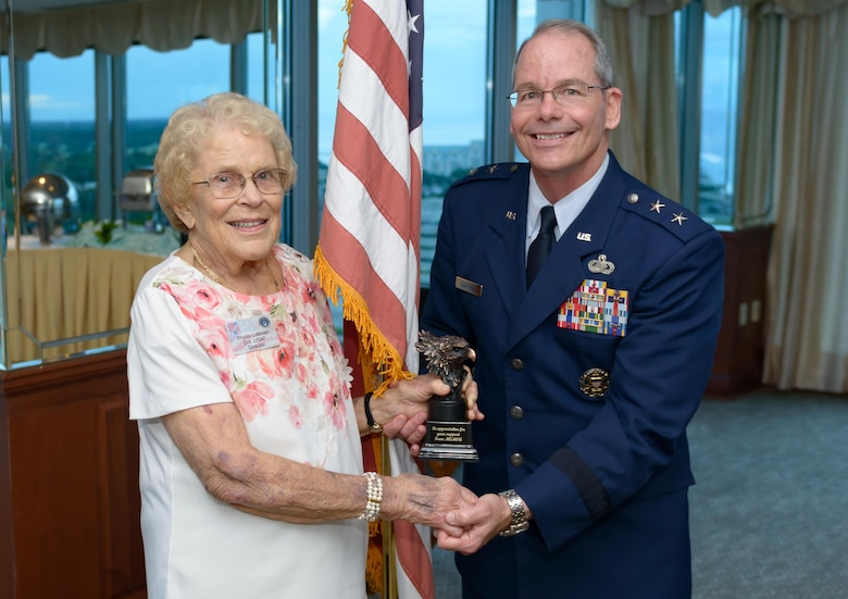 Retired Col. Phyllis Luttman, Mississippi Coast Military Officers Association vice president, presents Maj. Gen. Bob LaBrutta, 2nd Air Force commander, with a token of appreciation during the MCMOA dinner at the Great Southern Club July 12, 2017, Gulfport, Miss. The dinner was held to familiarize the MCMOA members with the current readiness level of the 2nd AF. (U.S. Air Force photo by Andre' Askew)