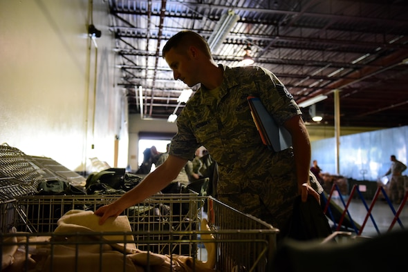 Tech Sgt. Austin Weinman, 4th Operations Support Squadron non-commissioned officer in charge of 335th Fighter Squadron aircrew flight equipment, takes issued equipment for exercise Thunderdome 17-02, July 20, 2017, at Seymour Johnson Air Force Base, North Carolina. During the first phase of the exercise, deploying members were identified, medically cleared, equipped with any necessary gear and briefed on all information needed to conduct operations in the simulated area of responsibility. (U.S. Air Force photo by Airman 1st Class Kenneth Boyton)