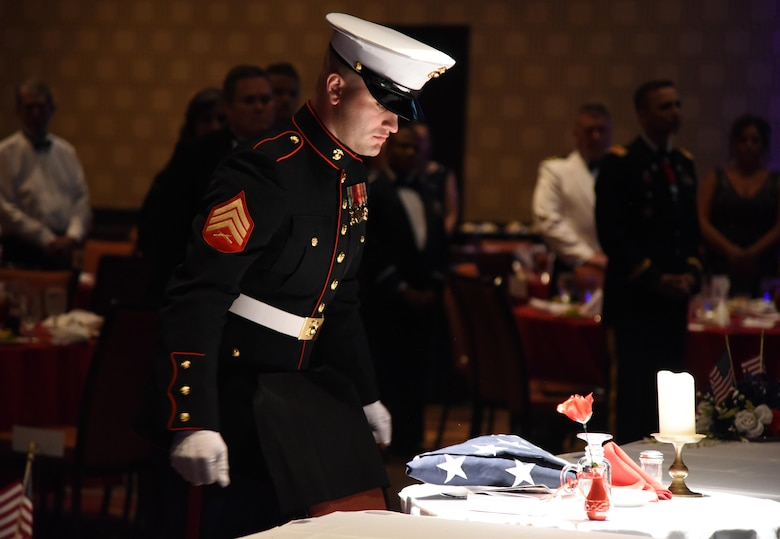 U.S. Marine Corps Sgt. Paul Tutor, Keesler Marine Detachment instructor, participates in a POW/MIA ceremony during the 2nd Annual Crusaders for Veterans Freedom Ball at the Golden Nugget Hotel and Casino July 15, 2017, in Biloxi, Miss. During the event, Crusaders for Veterans, a volunteer organization focused on helping veterans in need, held the event to recognize the careers of current military commanders in the local area. (U.S. Air Force photo by Kemberly Groue)
