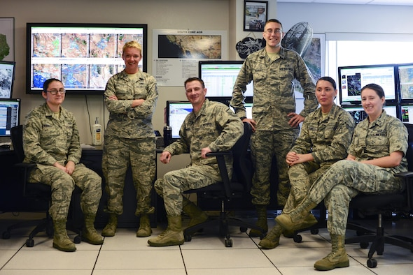 U.S. Airmen from the 25th Operational Weather Squadron pose for a photograph at Davis-Monthan Air Force Base, Ariz., July 19, 2017. The 25th OWS works 24 hours a day and seven days a week by monitoring the base's weather conditions and their potential effects on operations. (U.S. Air Force photo by Airman 1st Class Michael X. Beyer)