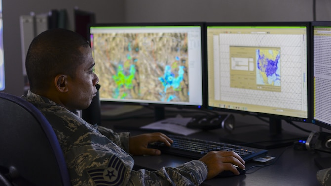 U.S. Air Force Tech. Sgt. Ryan Mendiola, 25th Operational Weather Squadron weather forecaster, monitors weather data at Davis-Monthan Air Force Base, Ariz., July 19, 2017. Forecasters from the 25th OWS monitor weather conditions for the western part of the Continental U.S. (U.S. Air Force photo by Airman 1st Class Michael X. Beyer)
