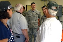 Capt. Ryon Migacz, 366th Training Squadron director of operations, speaks with members of the 555th Red Horse Squadron Vietnam Vets Reunion group during their visit, July 21, 2017. The 355th Red Horse Squadron was one of the first civil engineering units to arrive in Vietnam during the war. (U.S. Air Force photo by 2nd Lt. Jacqueline Jastrzebski)