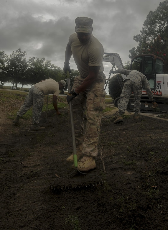 "Senior Airman Jason Mohamed, a pavements and construction equipment journeyman with the 1st Special Operations Civil Engineering Squadron, regrades a ditch on Hurlburt Field, Fla., July 18, 2017. The ""Dirt Boyz"" from the 1st SOCES releveled a ditch outside the 1st Special Operations Medical Group, maintaining efficient storm drains and preventing flooding. (U.S. Air Force photo by Airman 1st Class Rachel Yates)"