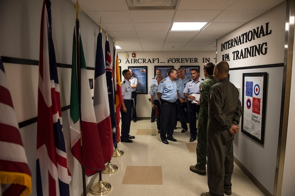 Brig. Gen. Enrique Amrein, Argentine air force chief of staff, meets members of Holloman Air Force Base's international remotely piloted aircraft training section here July 20, 2017. International relations are a major part of U.S. military operations, providing avenues for additional support in times of need. (U.S. Air Force photo by Senior Airman Chase Cannon)