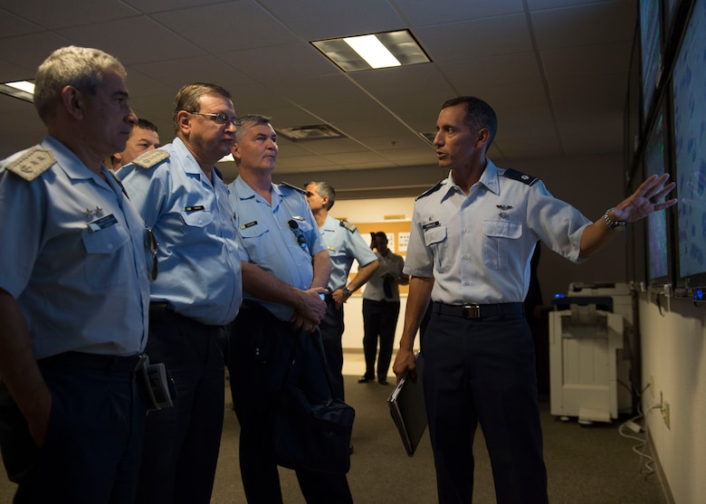 Lt. Col. Alfred Rosales, 6th Attack Squadron commander, explains remotely piloted aircraft operations to a contingent of Argentine air force officials including Brig. Gen. Enrique Amrein, Argentine air force chief of staff, at Holloman Air Force Base, N.M., July 20, 2017. While at Holloman, Amrein learned about the remotely piloted aircraft training program and what pilots, sensor operators and maintainers experience during their time here. (U.S. Air Force photo by Senior Airman Chase Cannon)