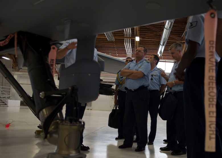 Brig. Gen. Enrique Amrein, Argentine air force chief of staff, learns about the capabilities of an MQ-9 Reaper at Holloman Air Force Base, N.M., July 20, 2017. While at Holloman, Amrein learned about the remotely piloted aircraft training program and what pilots, sensor operators and maintainers experience during their time here. (U.S. Air Force photo by Senior Airman Chase Cannon)