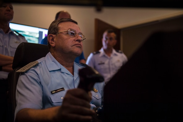 Brig. Gen. Enrique Amrein, Argentine air force chief of staff, operates an MQ-9 Reaper simulator at Holloman Air Force Base, N.M., July 20, 2017. While at Holloman, Amrein learned about the remotely piloted aircraft training program and what pilots, sensor operators and maintainers experience during their time here. (U.S. Air Force photo by Senior Airman Chase Cannon)