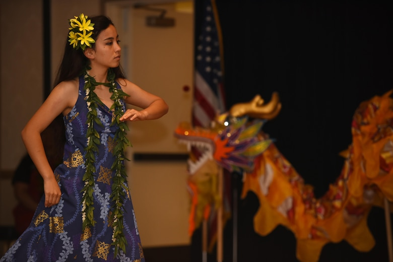"A member of Ka Lau Liko Lehua performs ""Hopoe,"" a traditional Hawaiian dance during a Diversity Day event, July 21, 2017, Vandenberg Air Force Base, Calif. Throughout the day, those in attendance were treated to a variety of ethnic dances, games, and delicacies. Additionally, there were stations spread out through the PCC Ballroom with information and fun facts about each ethnic group and their contributions to culture and society. (U.S. Air Force photo by Senior Airman Robert J. Volio/Released)"