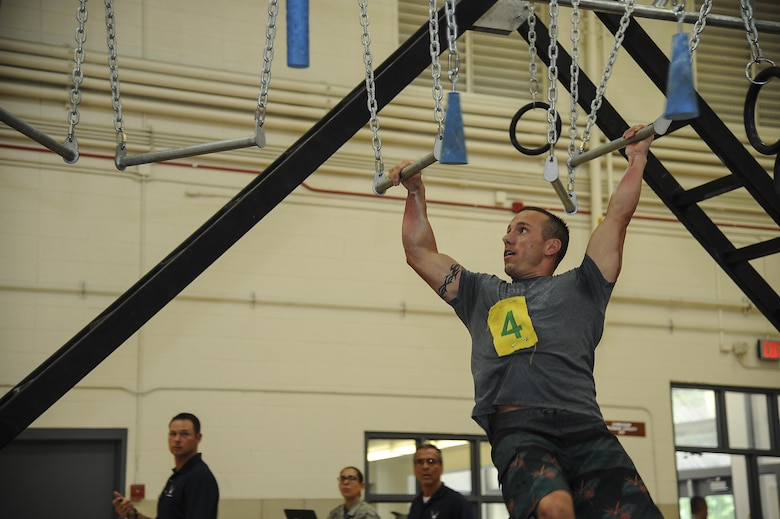 U.S. Air Force Master Sgt. Kevin Sitko, 355th Medical Group training manager, performs on broken bars during the Alpha Warrior Competition at Davis-Monthan Air Force Base, Ariz., July 21, 2017. The top three male and female finalists will move on to the regional competition that is scheduled to be held here in October. (U.S. Air Force photo by Senior Airman Mya M. Crosby)