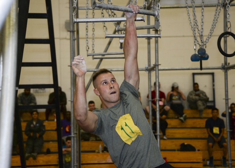 U.S. Air Force Airman 1st Class Sergiy Ivanstov, assigned to the 355th Logistics Readiness Squadron, dominates the broken bars during the Alpha Warrior Challenge at Davis-Monthan Air Force Base, Ariz., July 21, 2017. Sixteen competitors raced against the clock performing multiple moves of calisthenics to include broken bars, pipe bombs and battering rams, testing each participant's skill, agility and experience. (U.S. Air Force photo by Airman 1st Class Giovanni Sims)