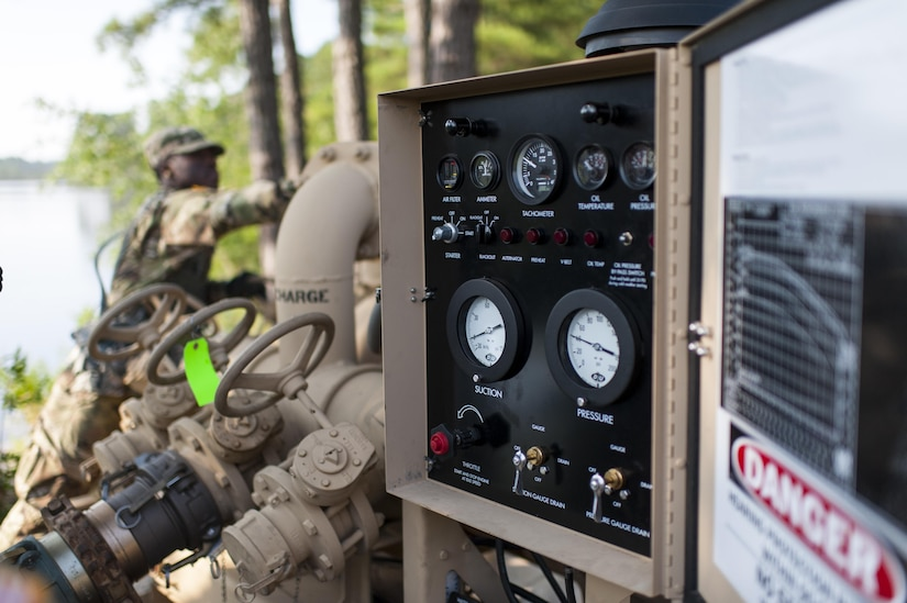 U.S. Army Reserve Soldiers with the 728th Quartermaster Company, Fremont, Neb., operate a pump on the Inland Pipeline Distribution System during QLLEX 2017, July 21, at Fort Bragg, NC. QLLEX, short for Quartermaster Liquid Logistics Exercise, is the U.S. Army Reserve's premier readiness exercise for fuel and water distribution. This year's QLLEX is not only a full demonstration of the capability, combat-readiness, and lethality of America's Army Reserve to put fuel and water where it is needed most – in the vehicles and hands of the war-fighter and maneuver units – but it also further exercises the interoperability of the U.S. Army Reserve alongside active Army and British Army logisticians. (U.S. Army Reserve photo by Timothy L. Hale) (Released)