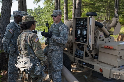 U.S.Army Reserve Sgt. James Powell, with the 728th Quartermaster Company, Fremont, Neb., explains the operation of the Inland Pipeline Distribution System during QLLEX 2017, July 21, at Fort Bragg, NC. QLLEX, short for Quartermaster Liquid Logistics Exercise, is the U.S. Army Reserve's premier readiness exercise for fuel and water distribution. This year's QLLEX is not only a full demonstration of the capability, combat-readiness, and lethality of America's Army Reserve to put fuel and water where it is needed most – in the vehicles and hands of the war-fighter and maneuver units – but it also further exercises the interoperability of the U.S. Army Reserve alongside active Army and British Army logisticians. (U.S. Army Reserve photo by Timothy L. Hale) (Released)