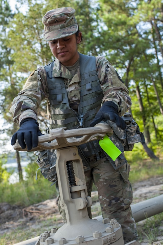 U.S. Army Reserve Pvt. Diana Hernandez, a petroleum supply specialist with the 728th Quartermaster Company, Fremont, Neb., closes a valve during QLLEX 2017, July 21, at Fort Bragg, NC. QLLEX, short for Quartermaster Liquid Logistics Exercise, is the U.S. Army Reserve's premier readiness exercise for fuel and water distribution. This year's QLLEX is not only a full demonstration of the capability, combat-readiness, and lethality of America's Army Reserve to put fuel and water where it is needed most – in the vehicles and hands of the war-fighter and maneuver units – but it also further exercises the interoperability of the U.S. Army Reserve alongside active Army and British Army logisticians. (U.S. Army Reserve photo by Timothy L. Hale) (Released)