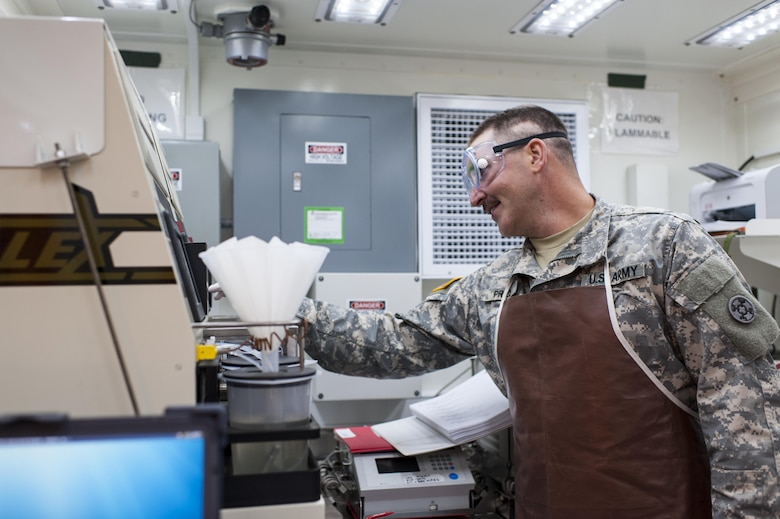 U.S. Army Reserve Spc. Andrew Price, a petroleum lab specialist with the 373rd Quartermaster Battalion, Jeffersonville, Ind., tests a fuel sample during QLLEX 2017, July 21, at Fort Bragg, NC. QLLEX, short for Quartermaster Liquid Logistics Exercise, is the U.S. Army Reserve's premier readiness exercise for fuel and water distribution. This year's QLLEX is not only a full demonstration of the capability, combat-readiness, and lethality of America's Army Reserve to put fuel and water where it is needed most – in the vehicles and hands of the war-fighter and maneuver units – but it also further exercises the interoperability of the U.S. Army Reserve alongside active Army and British Army logisticians. (U.S. Army Reserve photo by Timothy L. Hale) (Released)