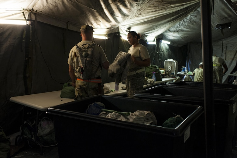 U.S. Army Reserve Soldiers with the 275ht Quartermaster Company, Fort Pickett, Va., sort and fold clean laundry during QLLEX 2017, July 21, at Fort Bragg, NC. QLLEX, short for Quartermaster Liquid Logistics Exercise, is the U.S. Army Reserve's premier readiness exercise for fuel and water distribution. This year's QLLEX is not only a full demonstration of the capability, combat-readiness, and lethality of America's Army Reserve to put fuel and water where it is needed most – in the vehicles and hands of the war-fighter and maneuver units – but it also further exercises the interoperability of the U.S. Army Reserve alongside active Army and British Army logisticians. (U.S. Army Reserve photo by Timothy L. Hale) (Released)
