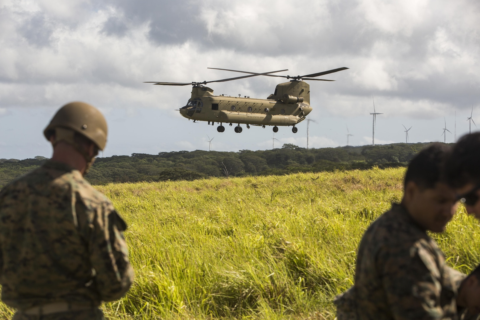 SCHOFIELD BARRACKS – A CH-47 Chinook helicopter prepares to land during an airborne parachute training exercise at Schofield Barracks, July 14, 2017. Marines with 4th Force Reconnaissance Company trained with U.S. Army Special Forces to maintain proficiency in completing static line and high altitude free fall airborne jumps. (U.S. Marine Corps photo by Lance Cpl. Isabelo Tabanguil)