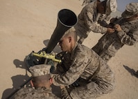 U.S. Marines with 1st Battalion, 1st Marine Regiment, Marine Air-Ground Task Force-8 (MAGTF) establishes a M252 81mm mortar system for mortar familiarization training during Integrated Training Exercise (ITX) 5-17 at Marine Corps Air Ground Combat Center, Twentynine Palms, Calif., July 18, 2017. The purpose of ITX is to create a challenging, realistic training environment that produces combat-ready forces capable of operating as an integrated MAGTF. (U.S. Marine Corps Photo by Cpl. Justin M. Smith)