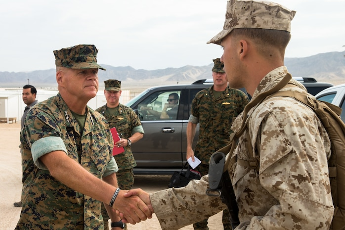 Commandant of the Marine Corps General Robert B. Neller shakes hands with Lance Cpl. Johnathan Sullivan, a fire team leader with Alpha Company, 1st Battalion, 1st Marine Regiment, Marine Air-Ground Task Force-8 (MAGTF), during Integrated Training Exercise 5-17 at Marine Corps Air Ground Combat Center Twentynine Palms, Calif, July 19, 2017. Neller met with senior leadership of MAGTF-8 to impart his guidance and leadership philosophy. (U.S. Marine Corps photo by Cpl. Christopher A. Mendoza)