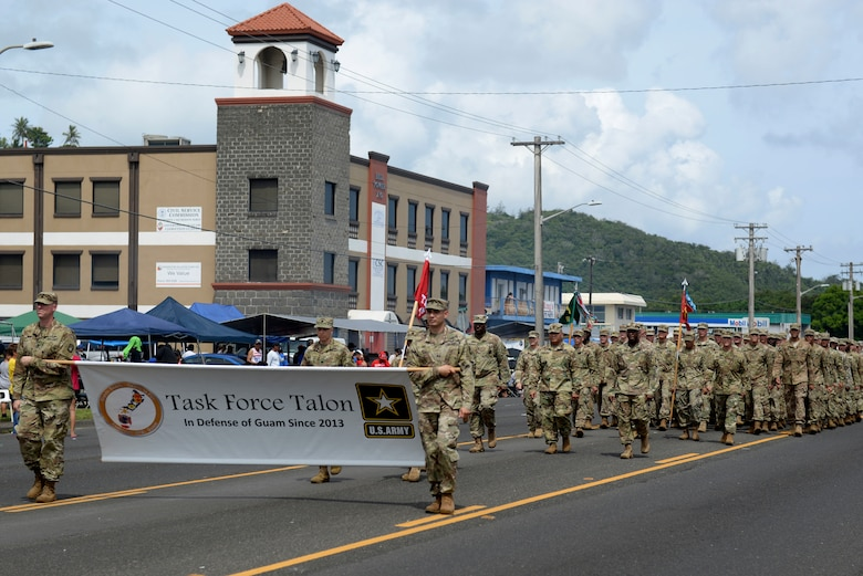 U.S. Soldiers assigned to Task Force Talon, 94th Army and Missile Command, and local citizens participate in the 73rd Guam Liberation Day parade July 21, 2017, in Hagåtña, Guam. Liberation Day is celebrated every year on July 21 to mark the day Guam was liberated by U.S armed forces from Japanese occupation in 1944. (U.S. Air Force photo by Airman 1st Class Gerald R. Willis)