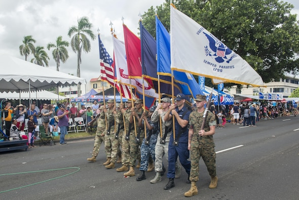 U.S. service members march during the 73rd Guam Liberation Day parade July 21, 2017, in Hagåtña, Guam. The parade commemorated 73 years since U.S. armed forces liberated the island from Japanese occupation. During World War II, Japan seized Guam on December 10, 1941, and on July 21, 1944, the U.S. armed forces liberated the island. (U.S. Air Force photo by Airman 1st Class Christopher Quail)