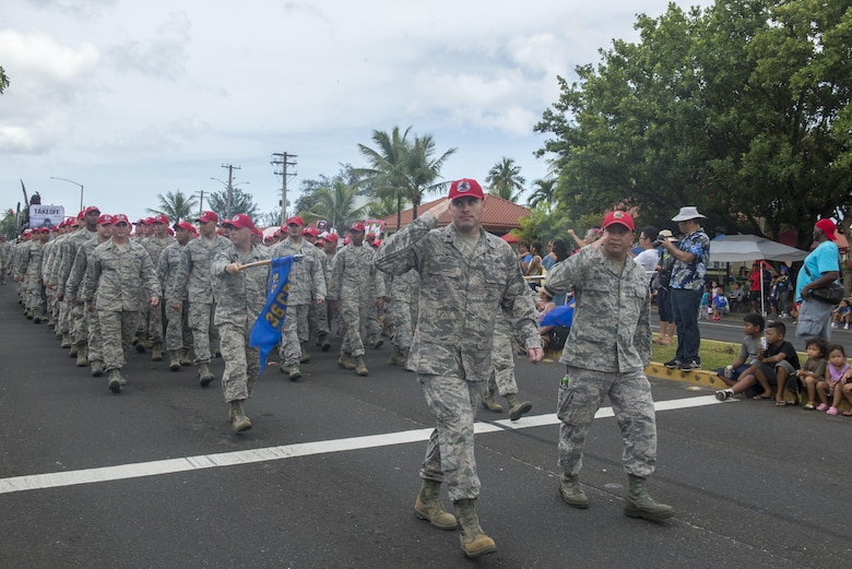 U.S. Airmen with the 554th RED HORSE Squadron, march in the 73rd Guam Liberation Day parade July 21, 2016, in Hagåtña, Guam. The parade commemorated 73 years since U.S. armed forces liberated the island from Japanese occupation. During World War II, Japan seized Guam on December 10, 1941, and on July 21, 1944, the U.S. armed forces liberated the island. (U.S. Air Force photo by Airman 1st Class Christopher Quail)