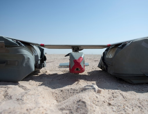 A RQ-11 Raven with the 379th Expeditionary Security Forces Squadron waits for take-off at Al Udeid Air Base, Qatar, July 3, 2017. The RQ-11 Raven is a small unmanned aircraft system which provides real-time imagery or video for the 379th ESFS. (U.S. Air Force photo by Tech. Sgt. Amy M. Lovgren)