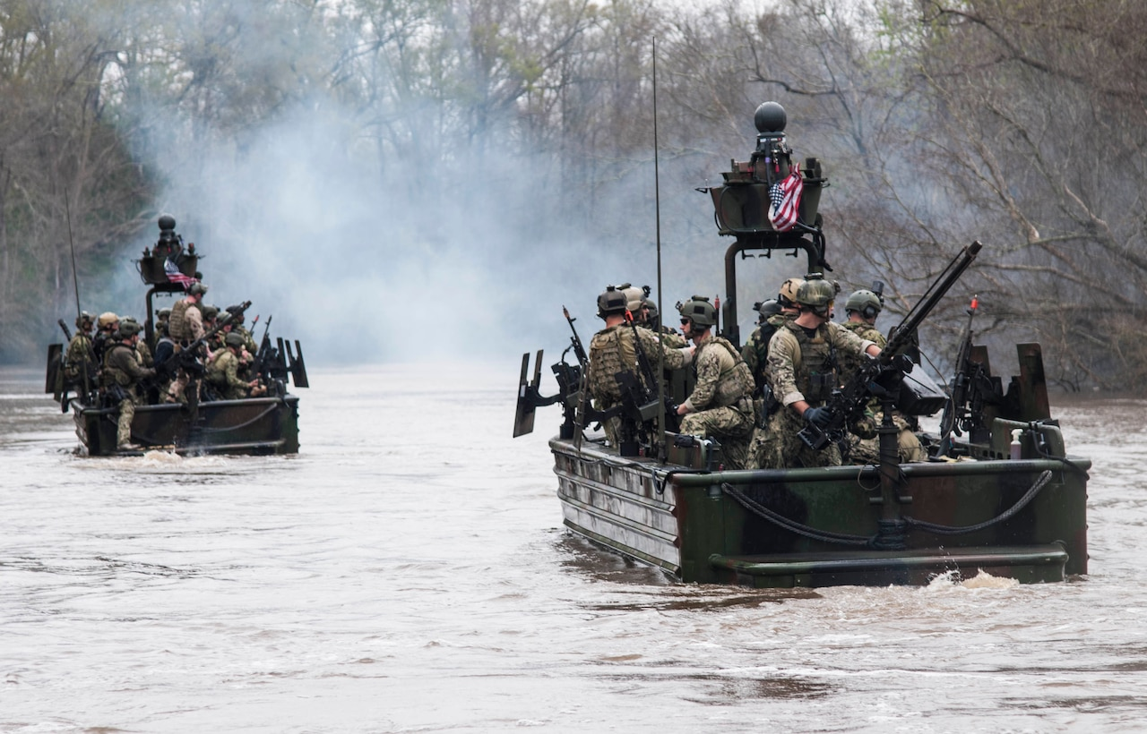 Army Lt. Gen. Raymond A. Thomas III, commander of, Joint Special Operations Command, participates in a riverine demonstration with members of Special Boat Team 22 at the Naval Small Craft Instruction and Technical Training School in Mississippi, March 12, 2015. Thomas now commands U.S. Special Operations Command. Navy photo by Seaman Richard Miller