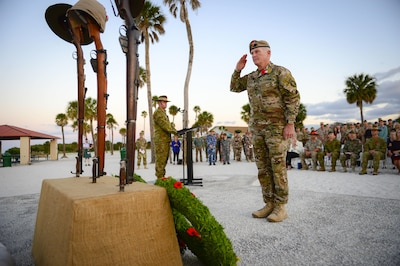Army Gen. Raymond A. Thomas III, commander of U.S. Special Operations Command, salutes after placing a wreath on a memorial in remembrance of Australian and New Zealand Army Corps Day, April 25, 2017, at MacDill Air Force Base, Fla. Anzac Day i marks the anniversary of the first major military action fought by Australian and New Zealand forces during WWI. Air Force photo by Tech. Sgt. Angelita Lawrence