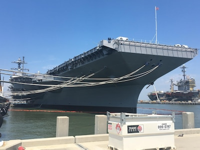 The aircraft carrier Gerald R. Ford is docked at Pier 11,Naval Station Norfolk, Va., June 30, 2017. The ship was undergoing preparations for its commissioning ceremony. The aircraft carrier USS George Washington is at background right. DoD photo by Thomas M. Ruyle
