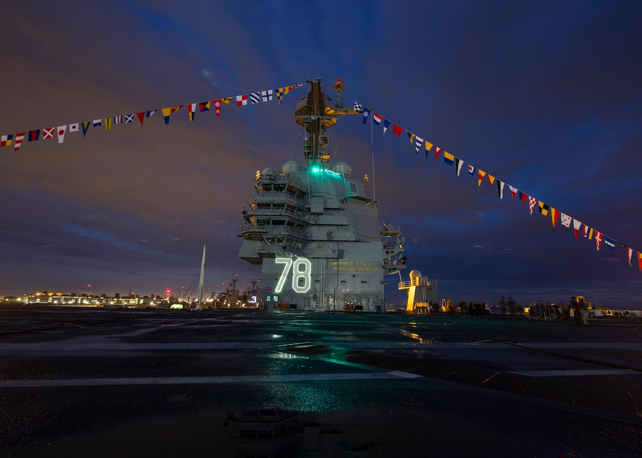"""The aircraft carrier Gerald R. Ford displays """"up and over"""" flags in observance of Independence Day while docked in Newport News, Va., July 4, 2017. The Ford was making preparations for its commissioning ceremony. Navy photo by Petty Officer 2nd Class Ryan Litzenberger"""