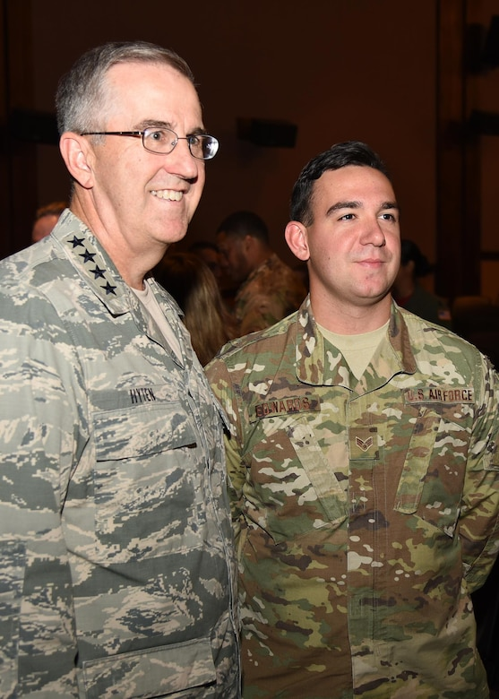 General John Hyten, commander of U.S. Strategic Command, poses for a photo with Senior Airman Ethan Edwards, member of the 90th Security Forces group, after an all-call at the F. E. Warren Air Force Base, Wyo., theater July 21, 2017. The Omaha Trophy is awarded to the best missile wing in USSTRATCOM. (U.S. Air Force photo by Glenn S. Robertson)